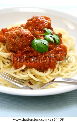 Plate of spaghetti with meat ball in rich tomato sauce. - stock photo