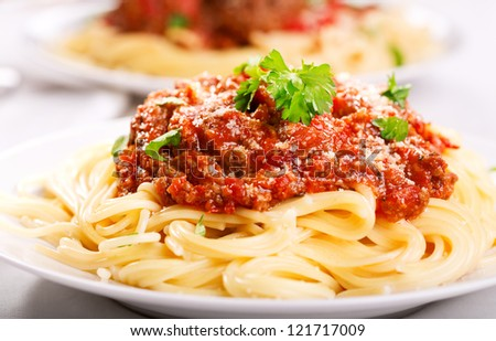 plate of spaghetti with meat sauce - stock photo