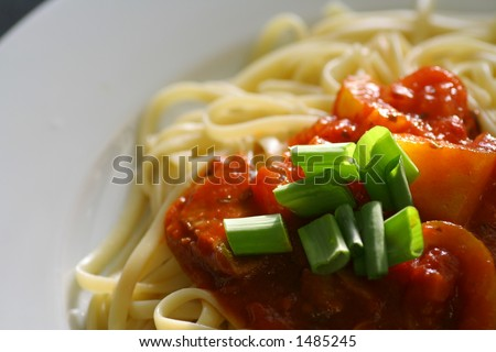 Plate of spaghetti with tomato sauce. Top view. - stock photo