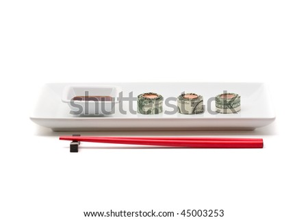 Plate of sushi made from money over white background - stock photo