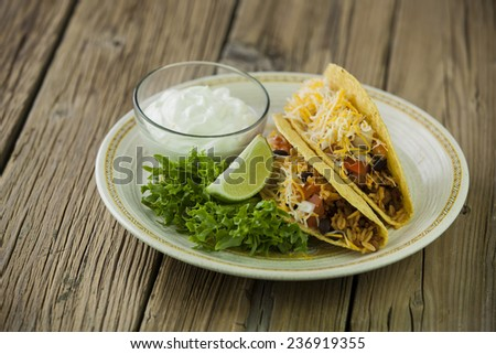 plate of taco on wooden table   - stock photo