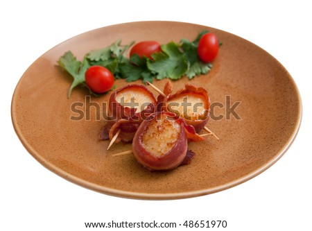 plate of three bacon wrapped scallops with cherry tomato garnish on a brown plate isolated on white - stock photo