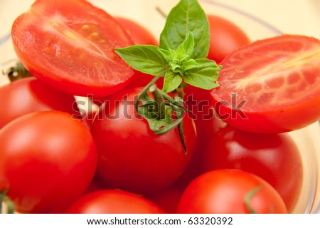Plate of tomato - Red  fresh tomatoes in a glass fish - stock photo