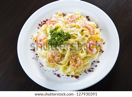 Plate of traditional Italian pasta topped with - stock photo