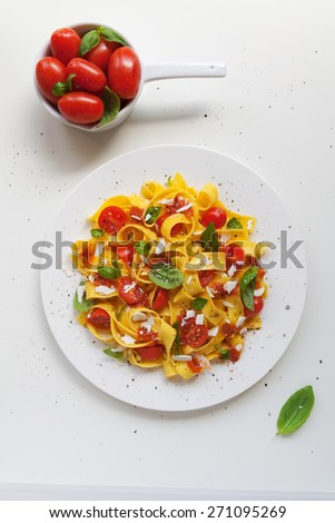 Plate of typical food Italian, tagliatelle pasta with tomato and basil - stock photo