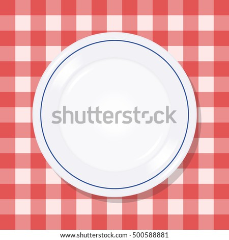 Plate on a red checkered tablecloth