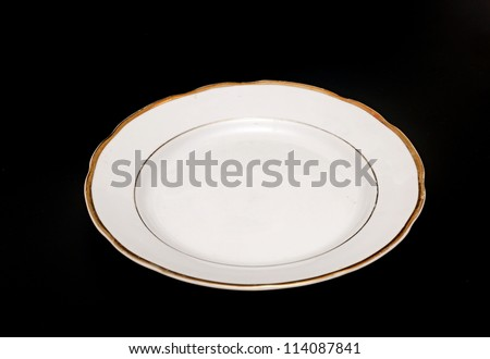 Plate on black background - stock photo