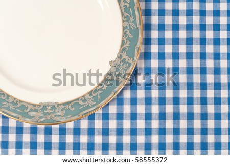 Plate on Blue Striped Table Cloth with Space for Text - stock photo