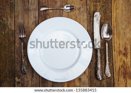 plate setting on an old wooden table