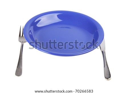 Plate with a plug and a knife on a white background - stock photo