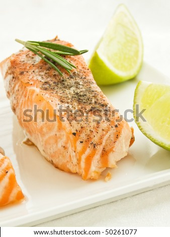 Plate with backed salmon steaks. Shallow dof. - stock photo