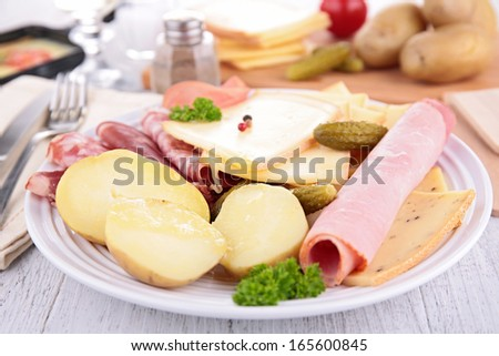 plate with cheese, ham, potato