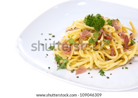 Plate with Cheese Spaetzle isolated on white background - stock photo