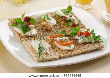 plate with different kinds of crispbread - stock photo