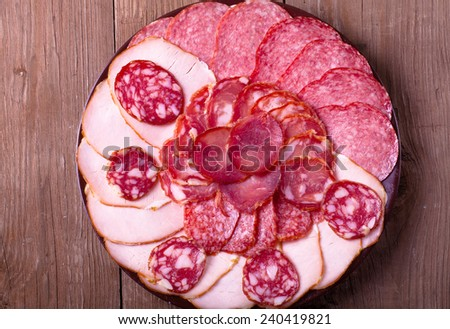 plate with different kinds of sausages - stock photo