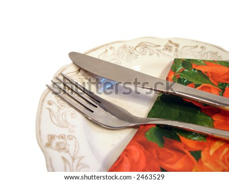 plate with fork and knife on red serviette - stock photo