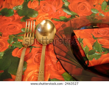 plate with fork and spoon on floral serviette - stock photo