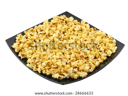Plate with fresh caramel popcorn. Isolated. - stock photo