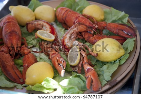plate with fresh lobster and lemons