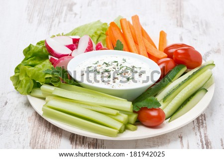 plate with fresh vegetables and thick yoghurt sauce, horizontal - stock photo