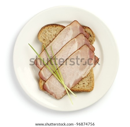 Plate with ham sandwich - stock photo