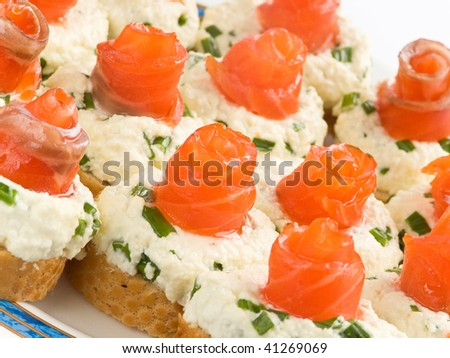 Plate with homemade sandwiches with smoked trout. Shallow dof.