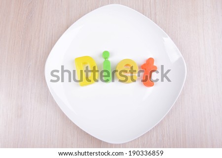 Plate with inscription on table close-up - stock photo