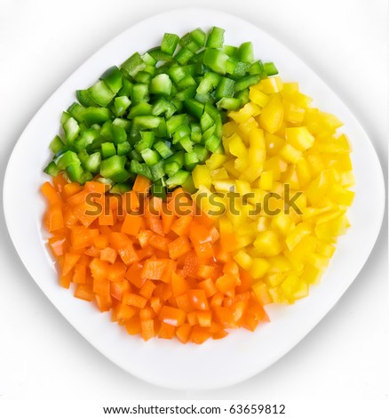 Plate with multicolored paprika slices - stock photo