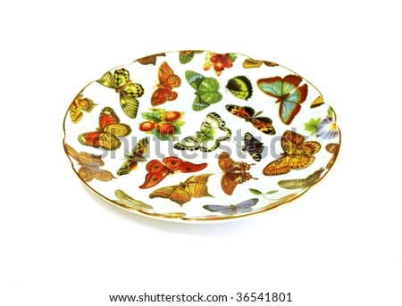 Plate with  ornament from butterflies isolated on white