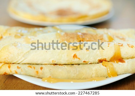 Plate with pancake on table