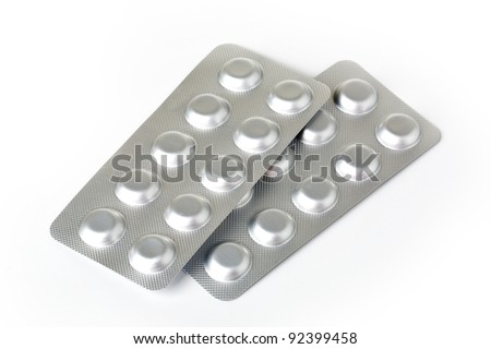 Plate with pills on a white background