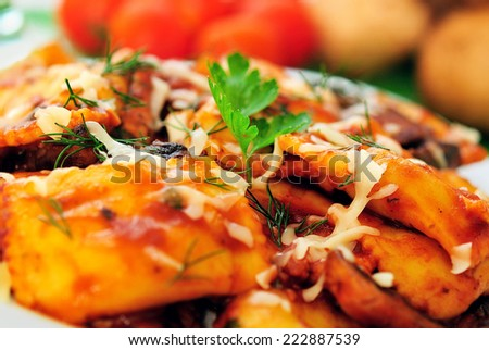Plate with ravioli on table - stock photo