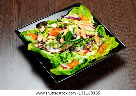 Plate with salad and chicken - stock photo