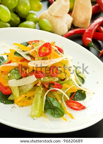 Plate with salad of mixed veggies and fruits. Shallow dof. - stock photo