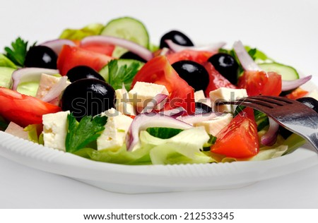 Plate with salad on gray background