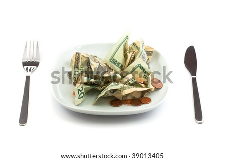 Plate with silverware and salad made from money - stock photo
