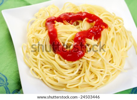 Plate with spaghetti and tomato  sauce in heart-shape