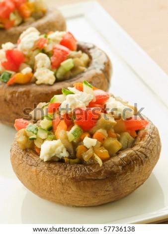 Plate with stuffed mushroom caps. Shallow dof. - stock photo