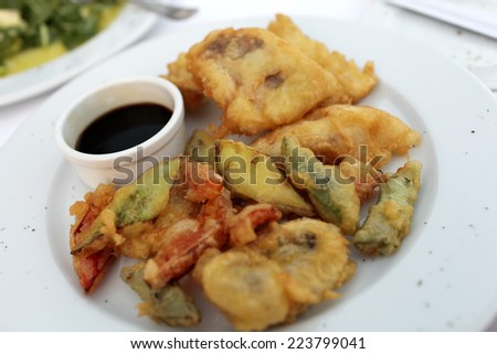 Plate with tempura fish and vegetables in the restaurant