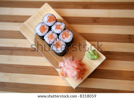 Plate with the Japanese delicacies and seasonings - stock photo