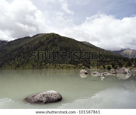 plateau landscape with the lake, mountain  and white cloud. - stock photo
