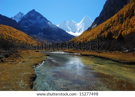Plateau snow-capped mountains with river, in the ya-ding scenic spots, daochen city ,china