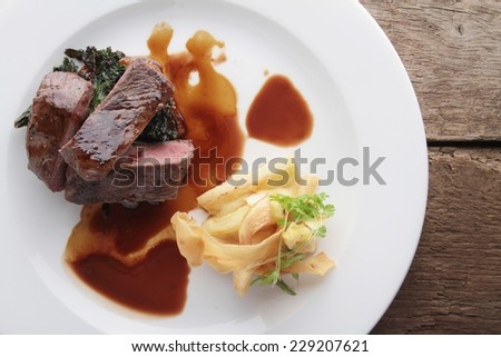 plated venison steak meal