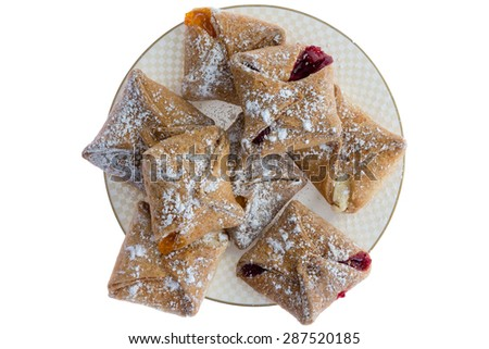 Plateful of crispy freshly baked crossover pastries filled with cheese and fruity preserve of peach and strawberry, overhead view isolated on white  - stock photo