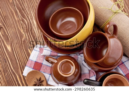plates and cups on wooden table