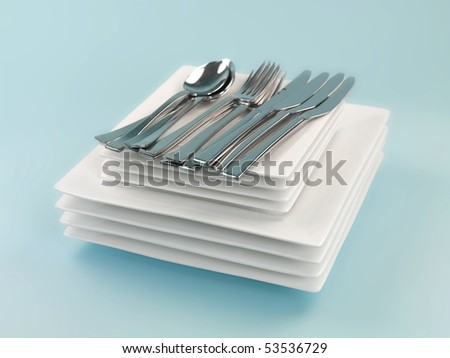 Plates and cutlery isolated against a blue background - stock photo