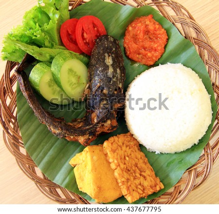 plates of Delicious fried fish- local flavor - stock photo