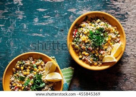 Plates of refreshing summer bulgar salad with fresh vegetables