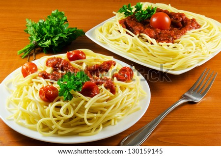 Plates of spaghetti on a wooden table