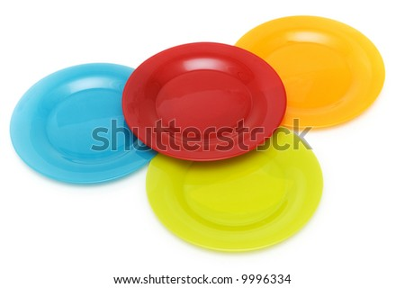 Plates of various colours isolated on the white